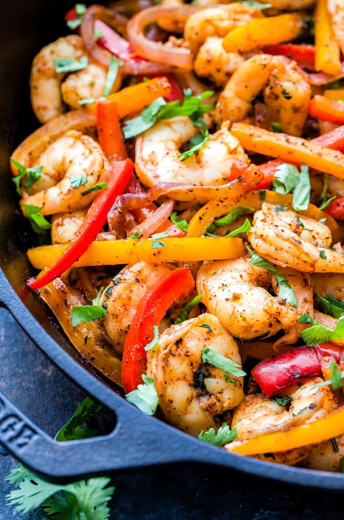 Skillet Shrimp Fajitas couldn't be easier to make and they'll be on your table in 30 minutes or less! Paleo, gluten-free and a great alternative to chicken or beef! #shrimp #fajitas #paleo #glutenfree #healthydinner #shrimpfajitas