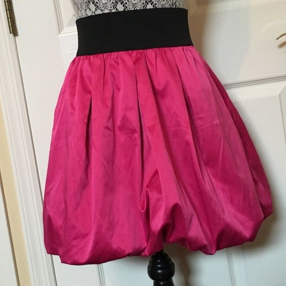 NWT Pink Satin Bubble Skirt NWT! Pink satin-like material skirt with bubble hem. Pockets on sides. Elastic black waist with silver zipper in back. love...ady Skirts