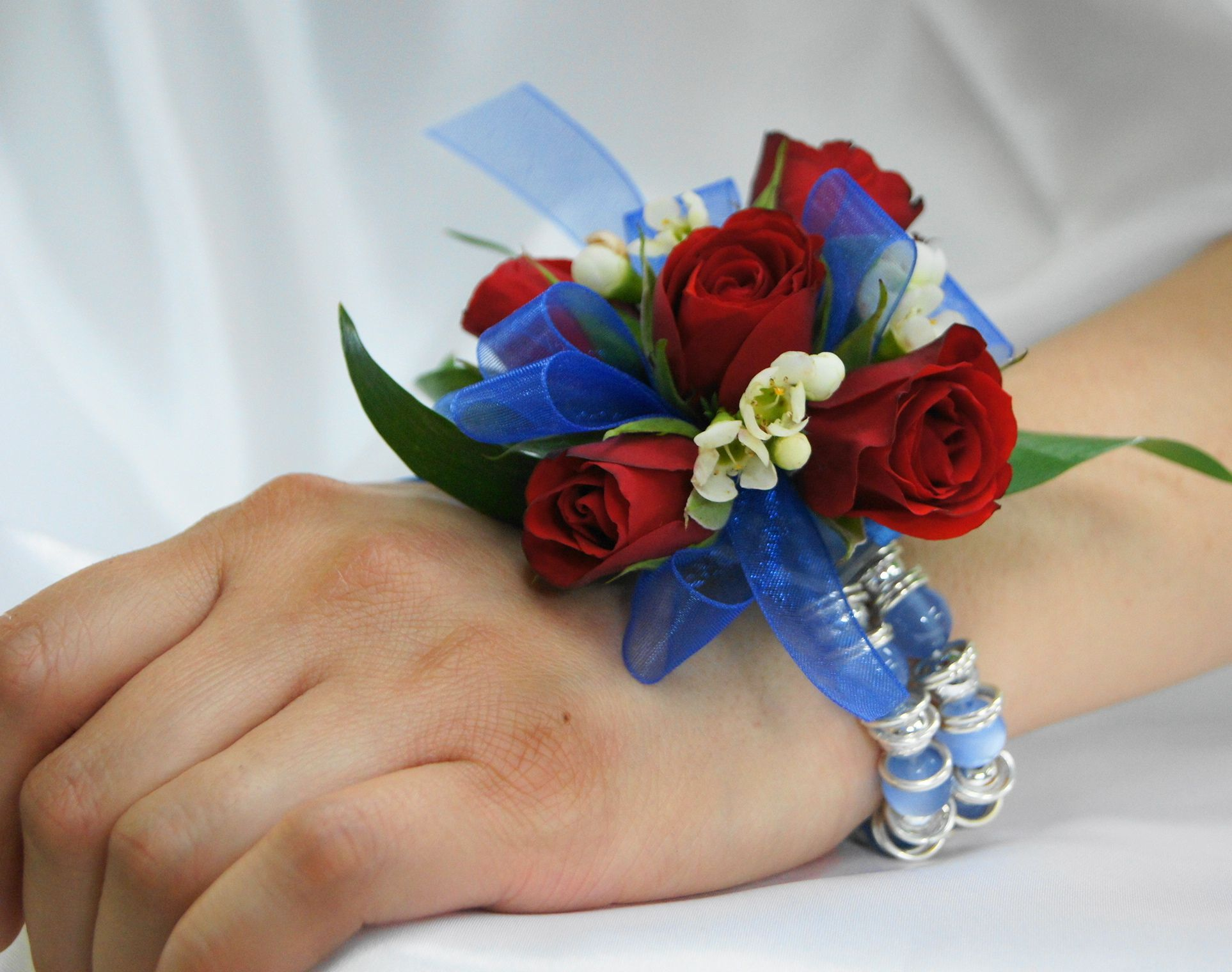 Red white and blue corsage for that special day by soderbergs red white and blue corsage for that special day by soderbergs floral minneapolis izmirmasajfo Gallery