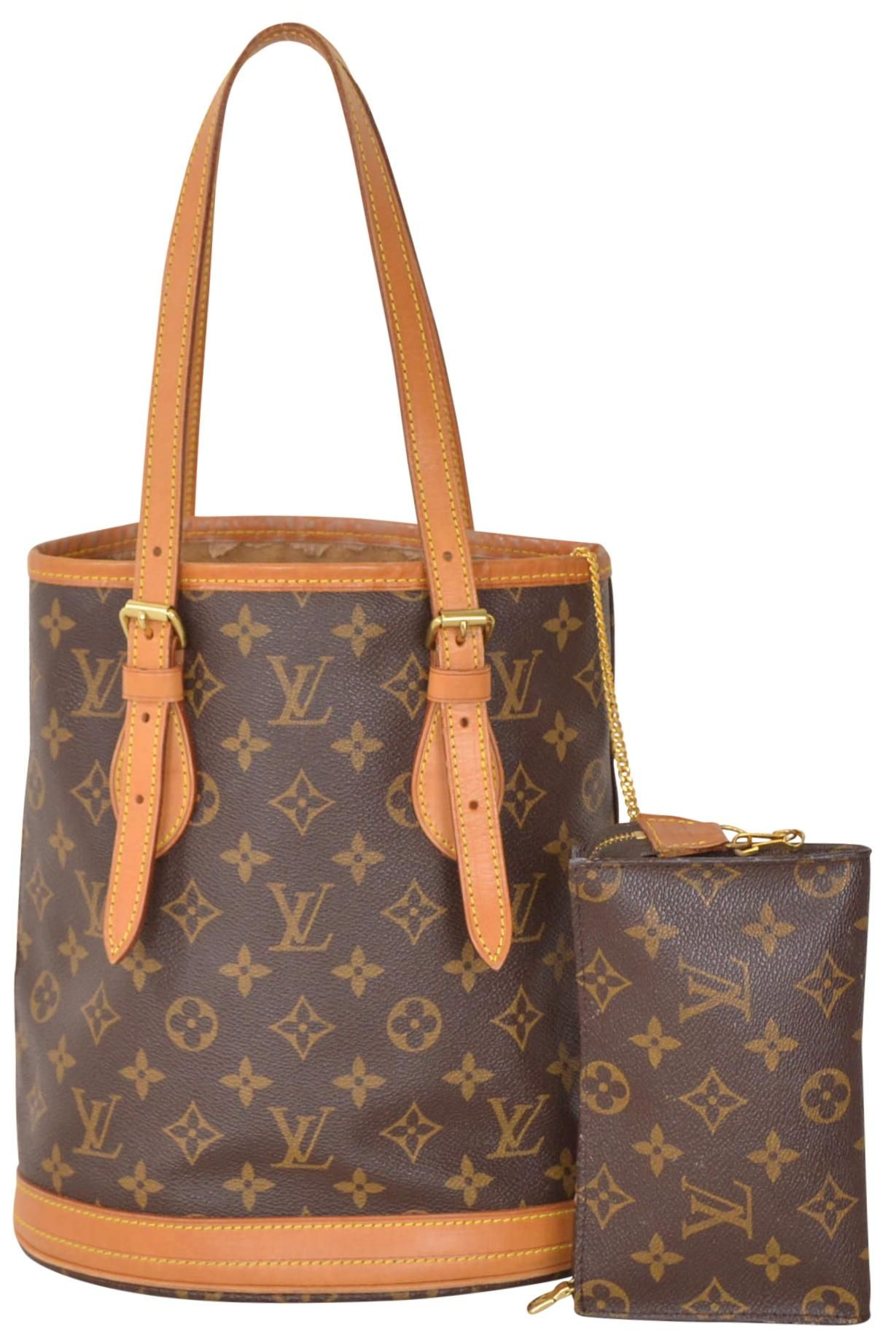 Louis Vuitton Monogram Bucket Pm M42238 Brown Tote Bag. Get one of the hottest styles of the season! The Louis Vuitton Monogram Bucket Pm M42238 Brown Tote Bag is a top 10 member favorite on Tradesy. Save on yours before they're sold out!