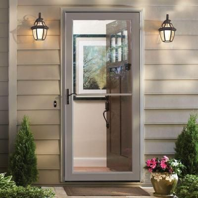 Andersen 36 In X 80 In 3000 Series Sandtone Left Hand Self Storing Easy Install Storm Door With Oil Rubbed Bronze Hardware 3soezl36sa The Home Depot Andersen Storm Doors Storm Door Aluminum Storm Doors
