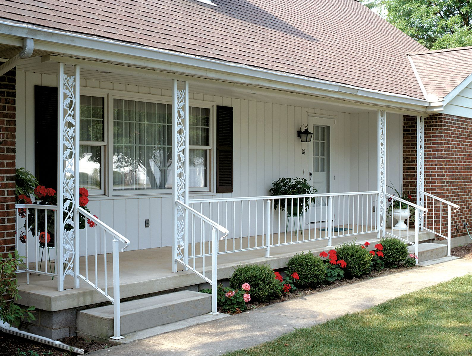 Residential Railing On A Front Porch With Decorative Columns Porch Columns Front Porch Columns Wrought Iron Porch Railings