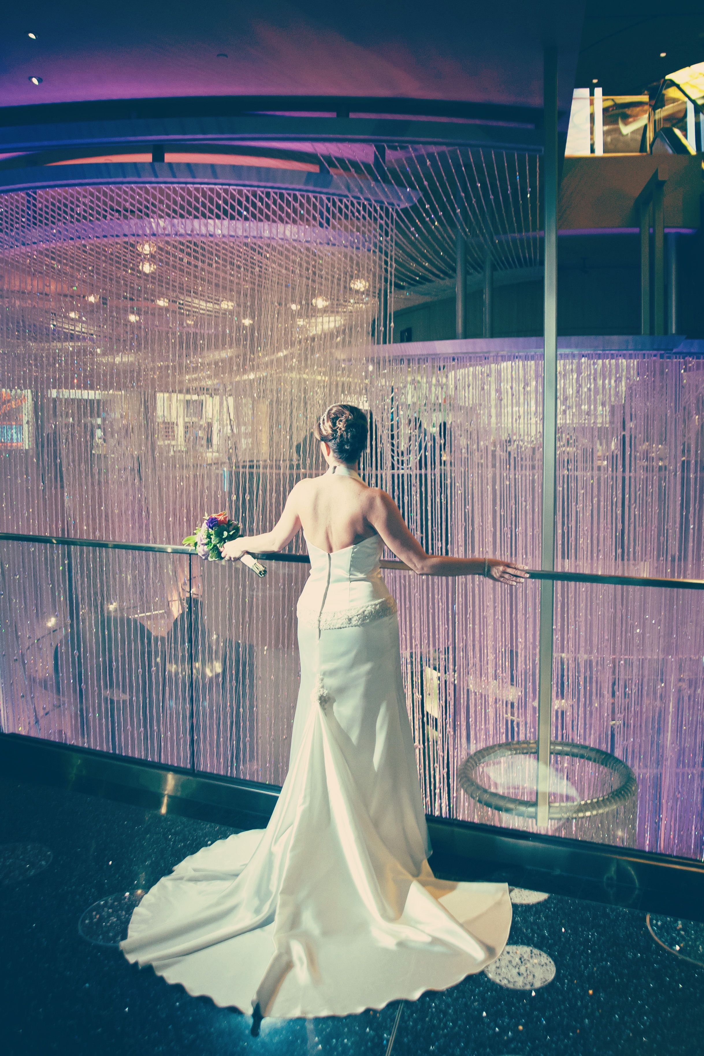 The Chandelier Makes A Dramatic Backdrop For Wedding Photos Planning Your Wedding Contact Our Top Wedding Photos Las Vegas Wedding Venue Vegas Wedding Venue
