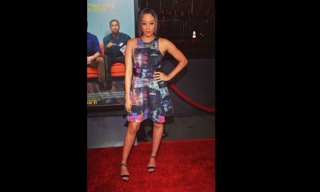 """TiaMowry-Hardrict wears Nicole Miller to the """"That Awkward Moment"""" premiere."""