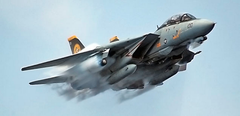 The Tomcat came in three different models: A, B, and D. Here, an F-14D — with twoGeneral Electric F-110 engines and the fully digital APG-71 radar system — makes a supersonic pass.