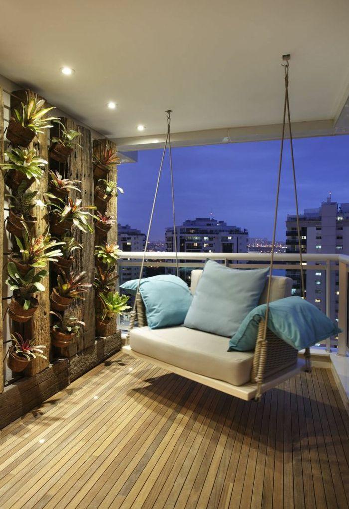 Decoracion de terrazas terraza con suelo de madera silla for Mesa colgante balcon