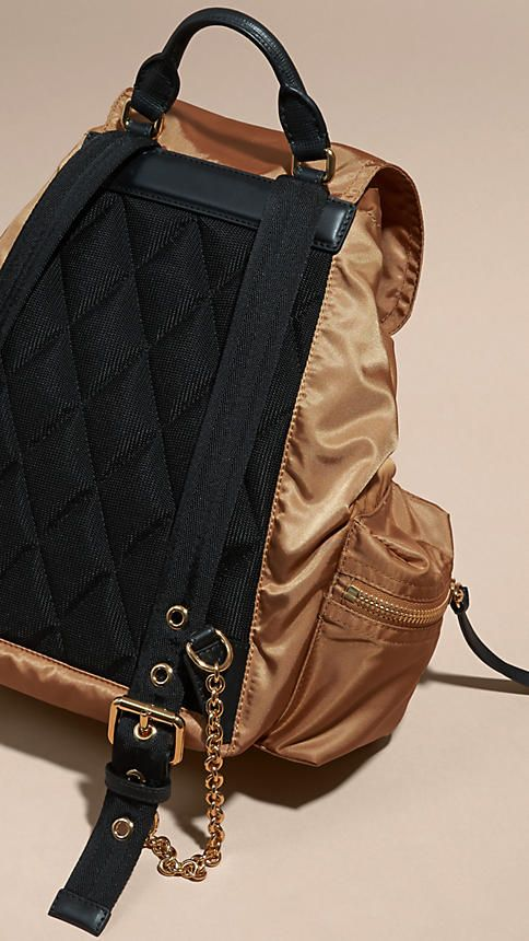 A lightweight showerproof Burberry rucksack with cushioned and polished metal chain shoulder straps and leather trims.