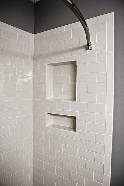 Vertical Subway Tile white subway tile featuring shower niche and bullnose edge tile