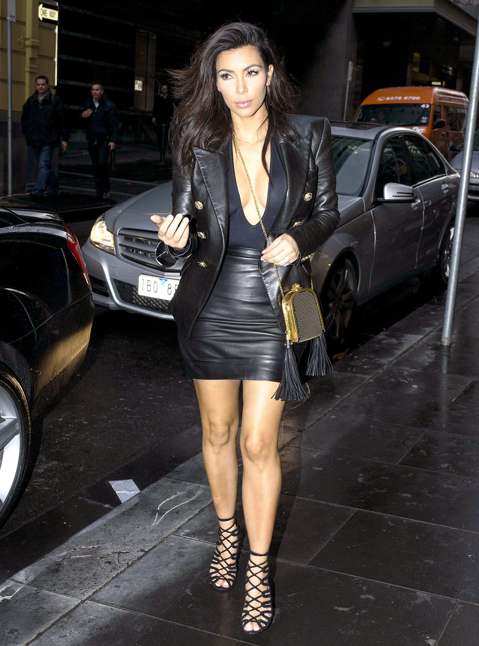 Kim Kardashian wears a plunging bodysuit and mini skirt while in Australia   see the star in a sexy all black leather look on Sept. 9 881c1b922f