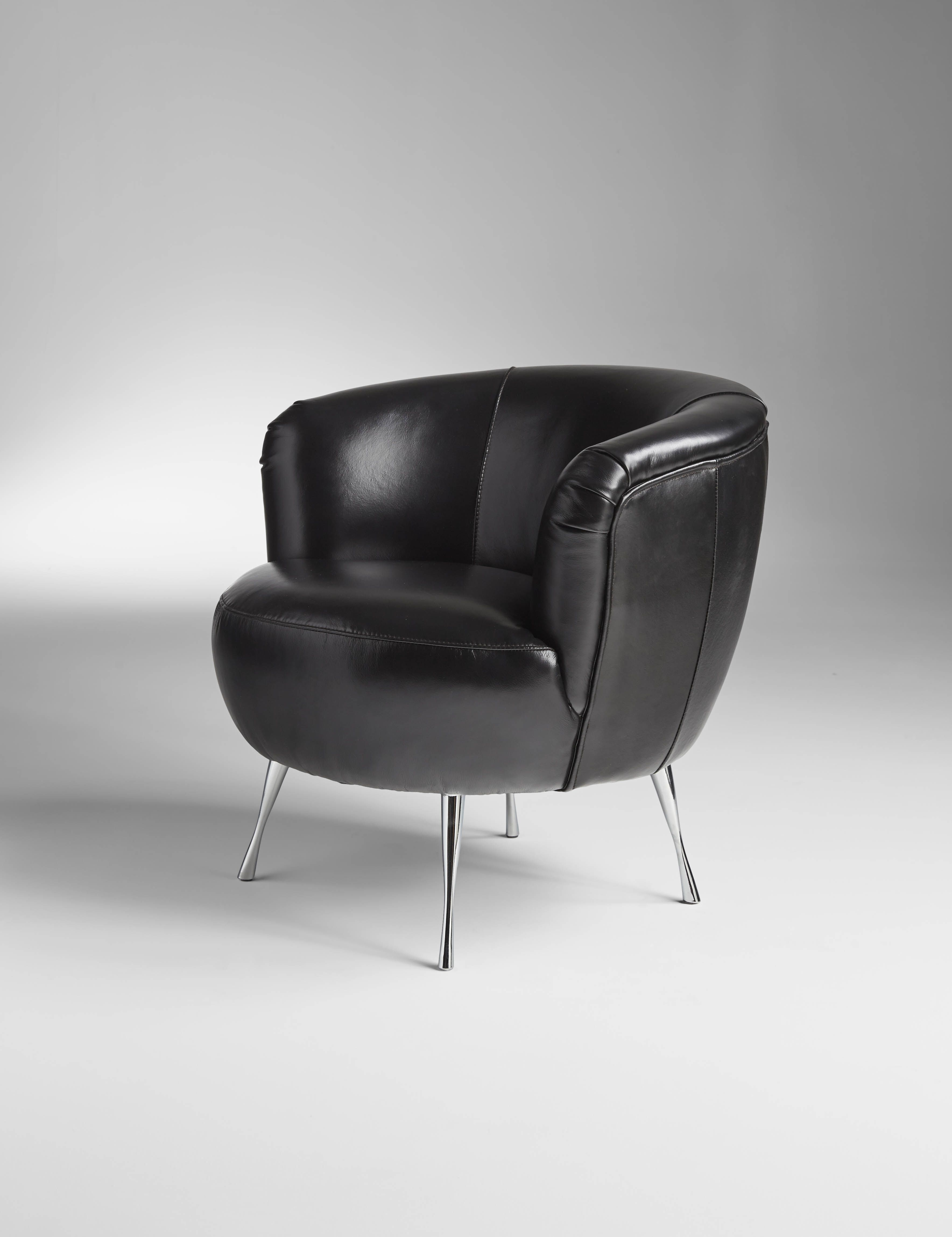 The Modena chair bines a puffy plush seat of Black & Tan or