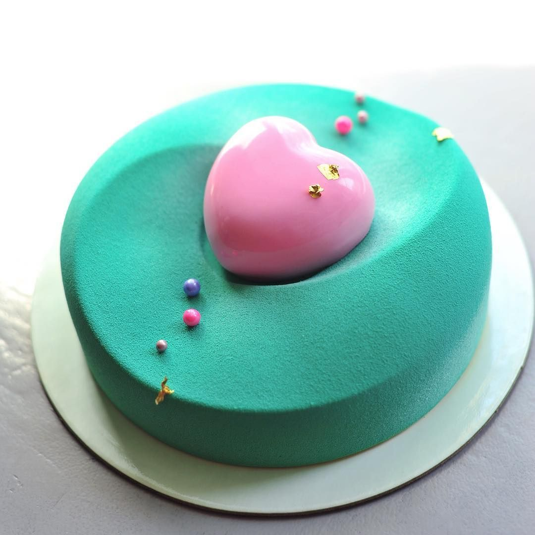 Modern turquoise cake with pink heart decoration by Anna Aksyonova