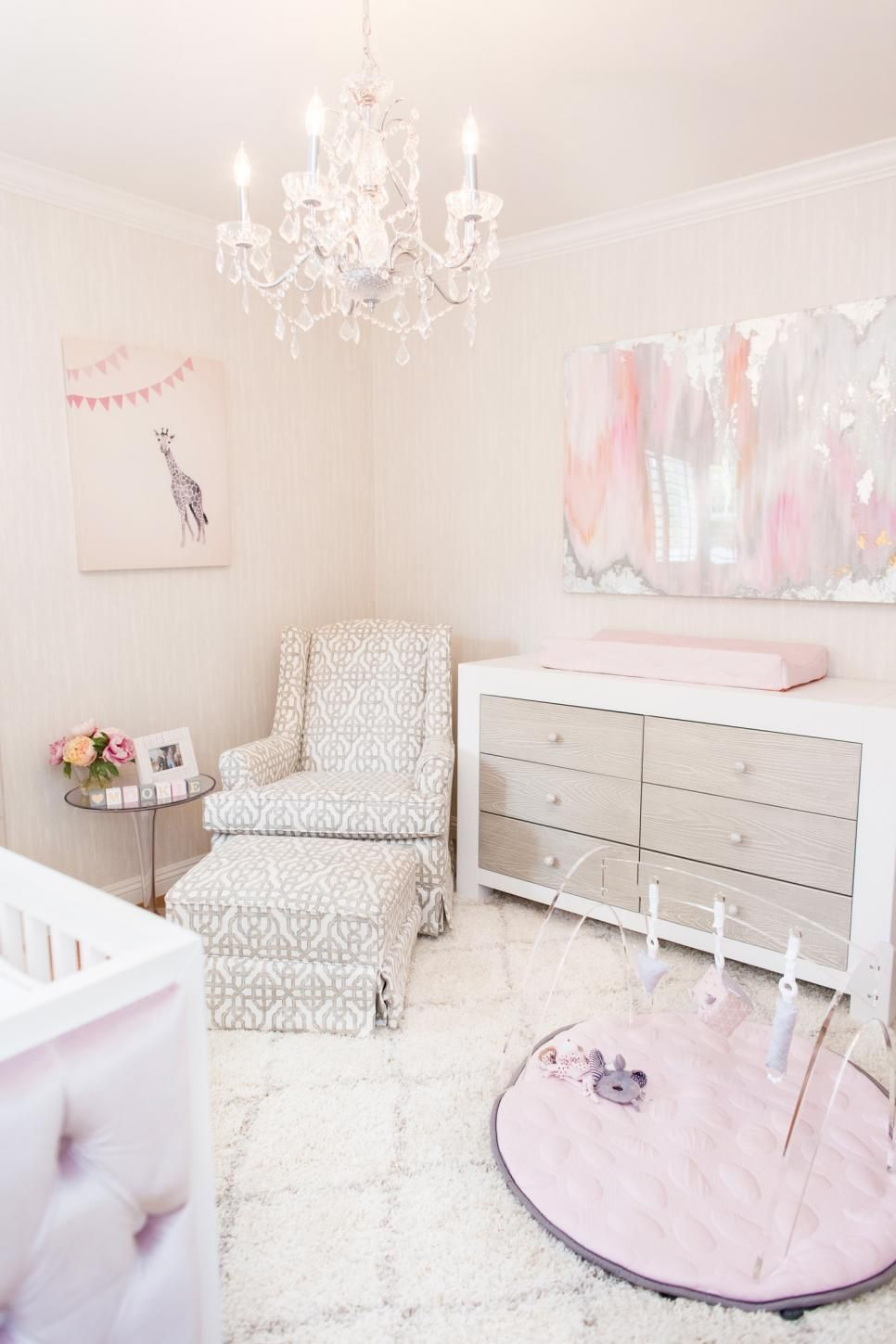 Pink Nursery With Crystal Chandelier And Custom Feminine Art