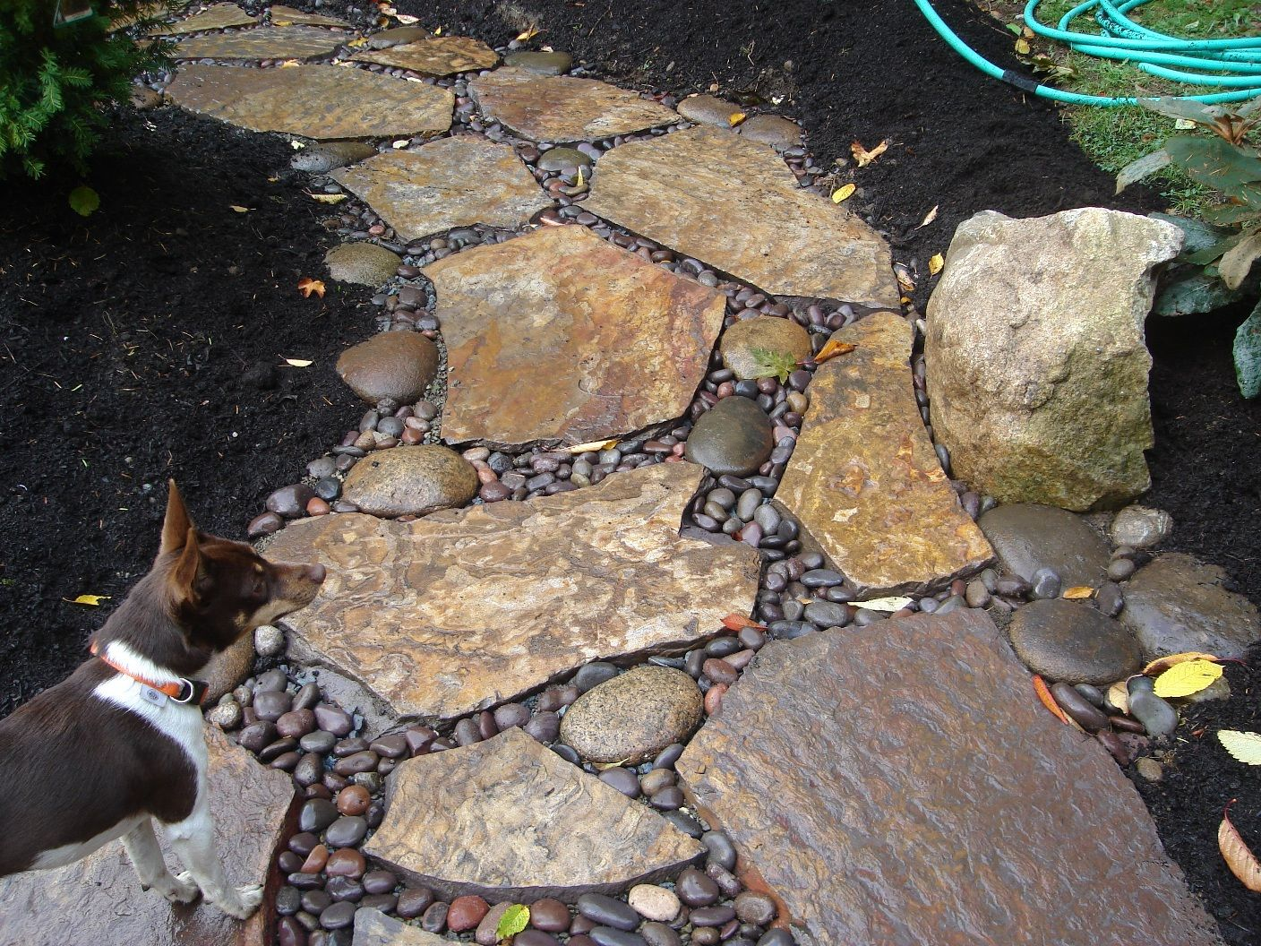 river stone patio | flagstone and river rock patio installed on ... - Rock Patio Ideas