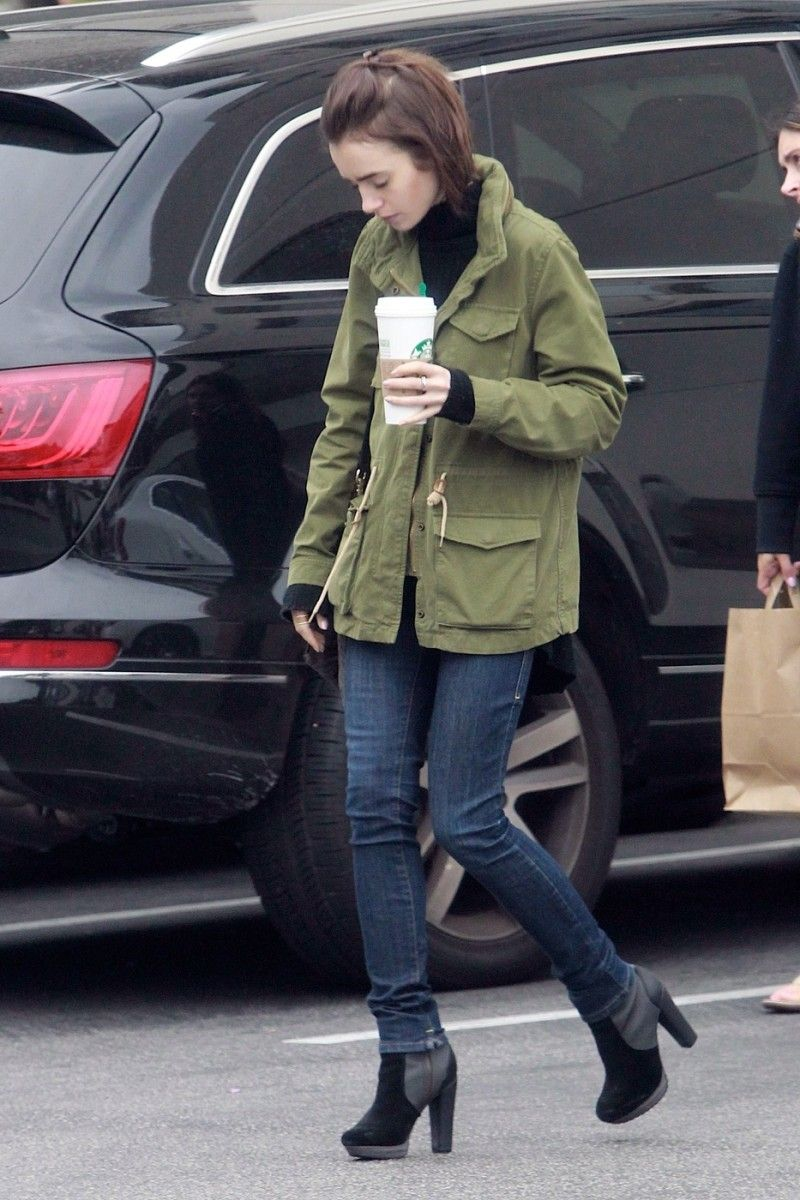 12791bde1 Lily Collins, casually on a coffee run with jeans, booties, combat olive  green jacket.