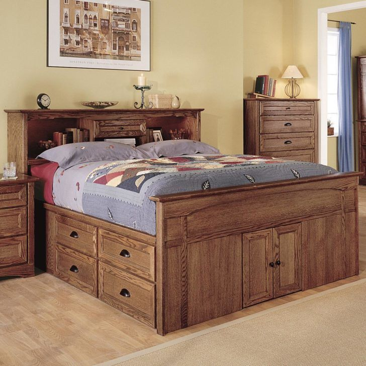 Brown Wooden Bed With Four Side Drawers Combined With Storage On The Front Side Also Shelves On Bed Frame With Drawers Bed Frame With Storage Storage Bed Queen
