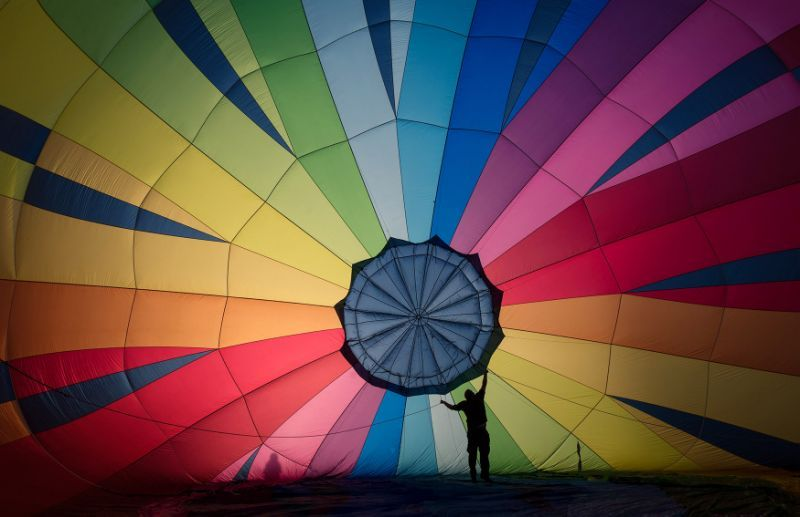 <p>A hot air balloon is prepared to take to the skies at a preview flight to launch next week's Bristol International Balloon Fiesta on Aug. 5, 2016 in Bristol, England. (Photo: Matt Cardy/Getty Images) </p>