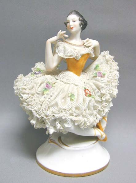 Dresden Lace figurine-real lace is dipped in porcelain and then fired to form the skirt-they started producing the first of these in Germany in the 1800's