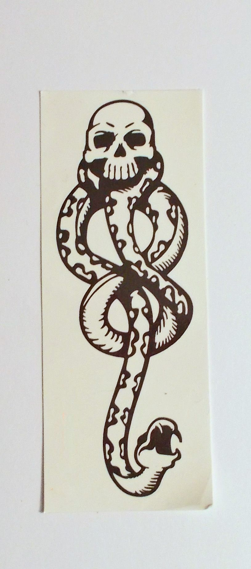 This is a temporary tattoo of the Dark Mark, the symbol of