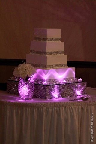 Simple & pretty square white cake + that is totally how you use submersible LED lights, lovely: http://www.flashingblinkylights.com/ledsubmersiblecraftlights-c-114_462.html