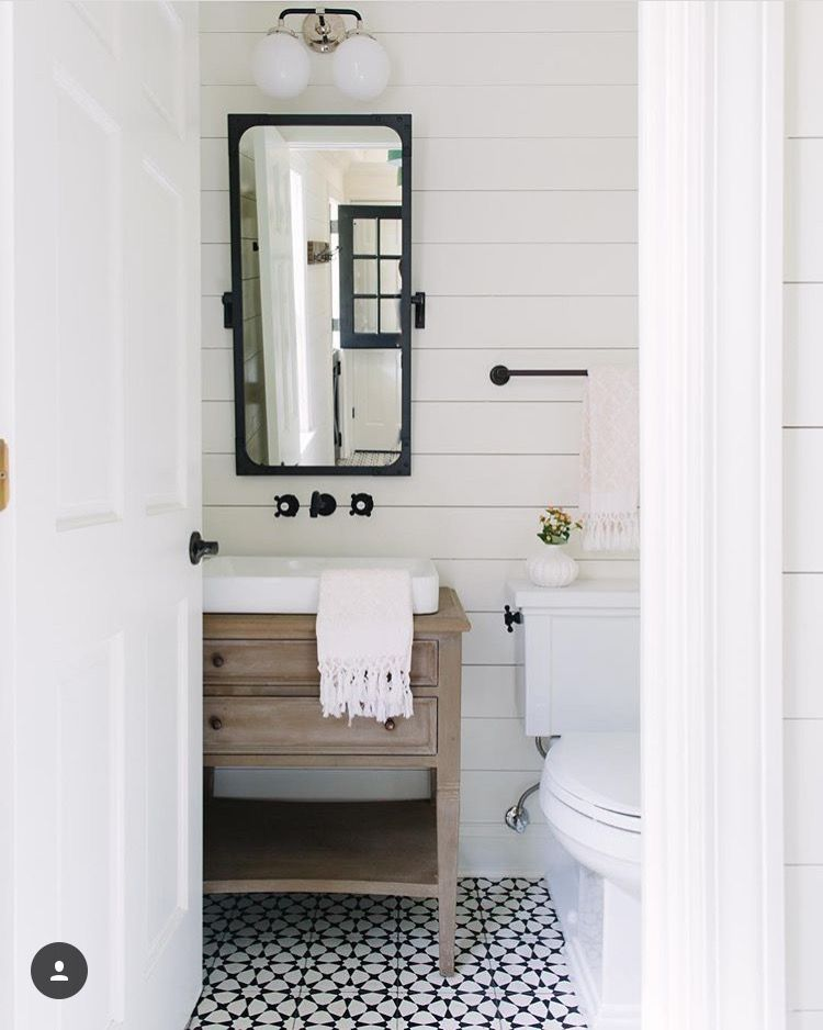 Bathroom: cement tile, bronze hardware, ship lap, wooden vanity.