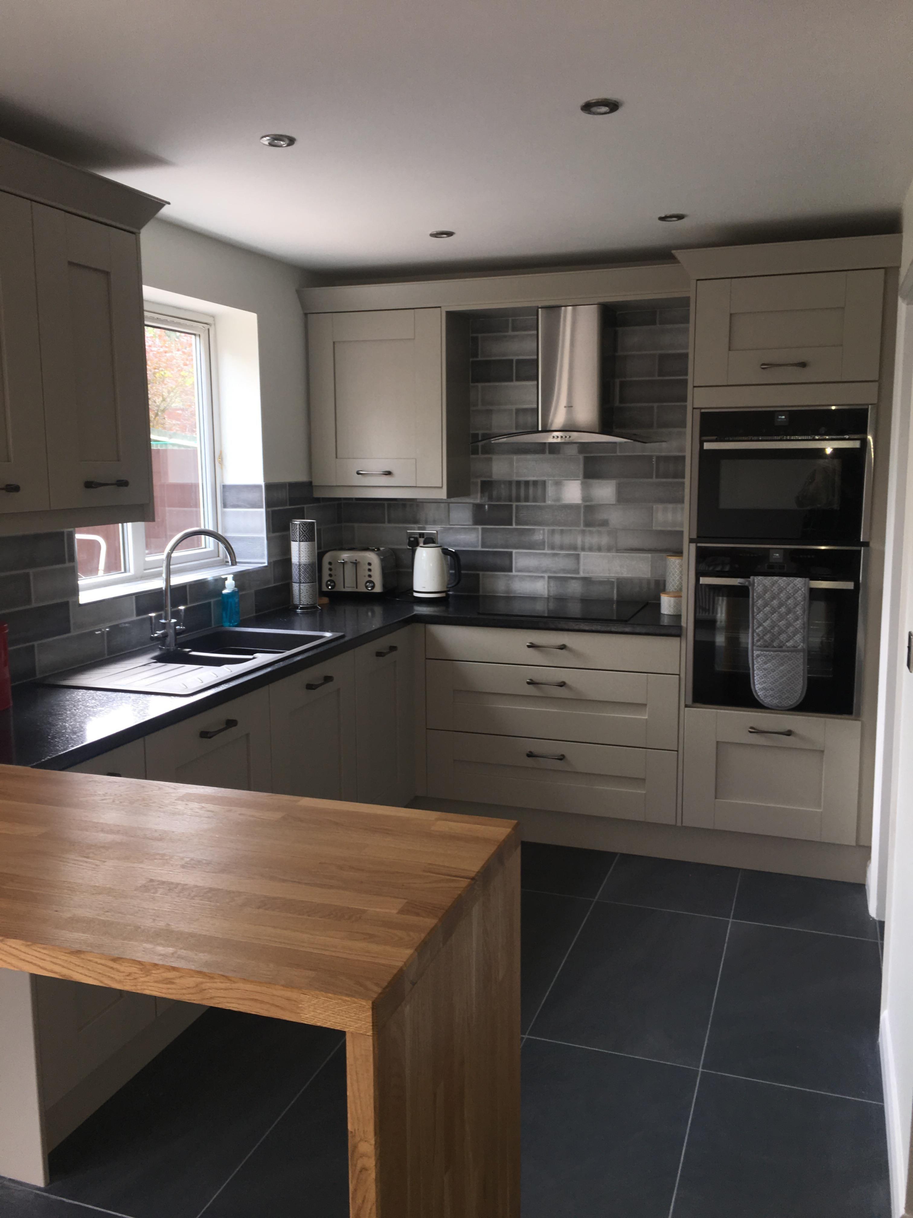 Second Nature kitchen Milbourne stone grey. Black laminate ...