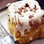 Pumpkin Pecan Cinnamon Rolls with Cream Cheese Frosting - Dora's Daily Dish #cinnamonrollpokecake