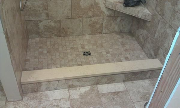 Lovely Capping Shower Curb With The Same Quartz Being Used On The Vanity.  Different Color Scheme