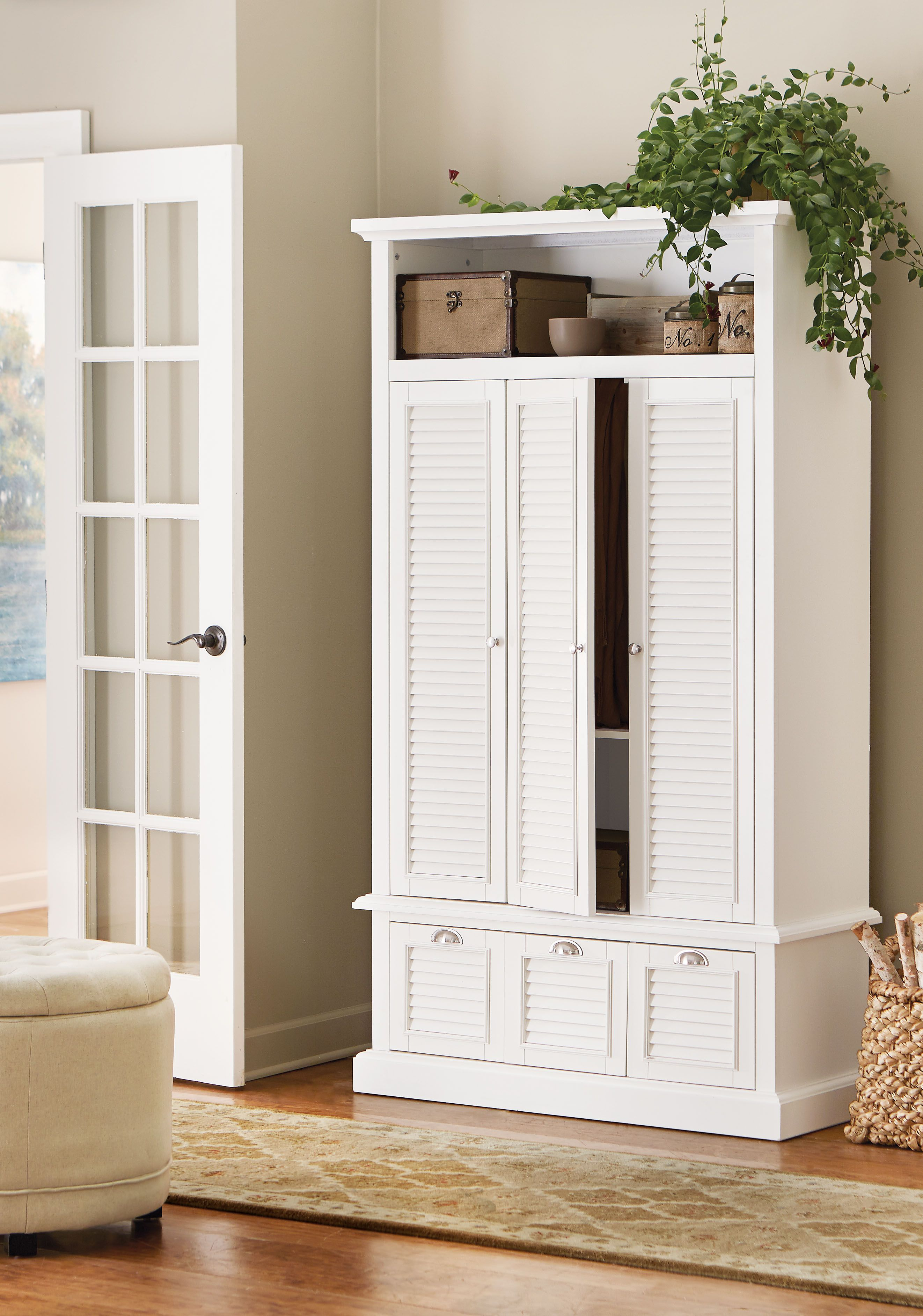 Keeping an entryway or hallway clutter free is easy with this eye-catching storage piece. HomeDecorators.com
