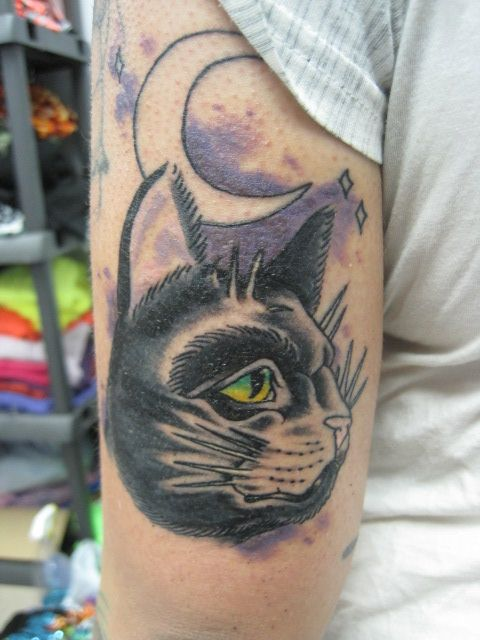 Cat and moon tattoo.