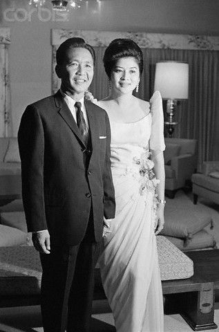 COSTUMES - Ferdinand and Imelda Marcos - SHE IS WEARING AN ELEGANTLY  DESIGNED GOWN