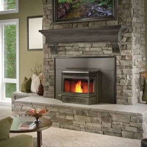 Stone fireplace surround with hearth stones and rustic wood mantle