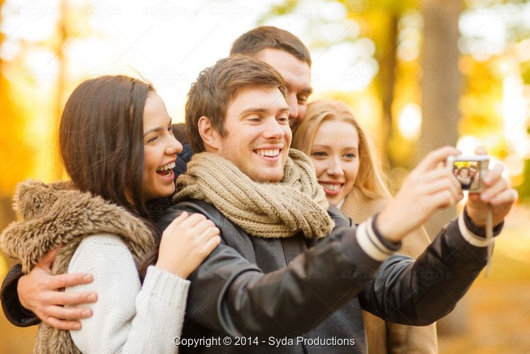 Syda Productions, group of friends with photo camera in autumn park - Stock Photos & Images | Stockafe.com #stockafe #stockphotography