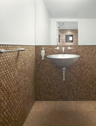 bathroom is fitted with cork flooring and cork penny tile on the walls - Cork Bathroom Interior