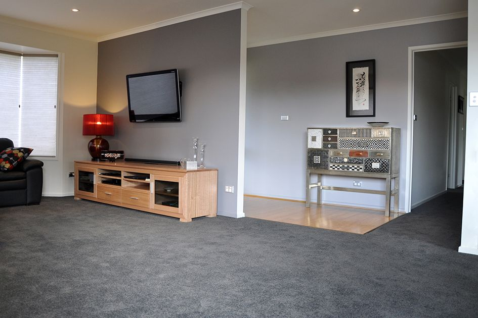 Soft Grey Paintwork Complimenting The Smokey Grey Carpet For A Harmonious Living Room Interior