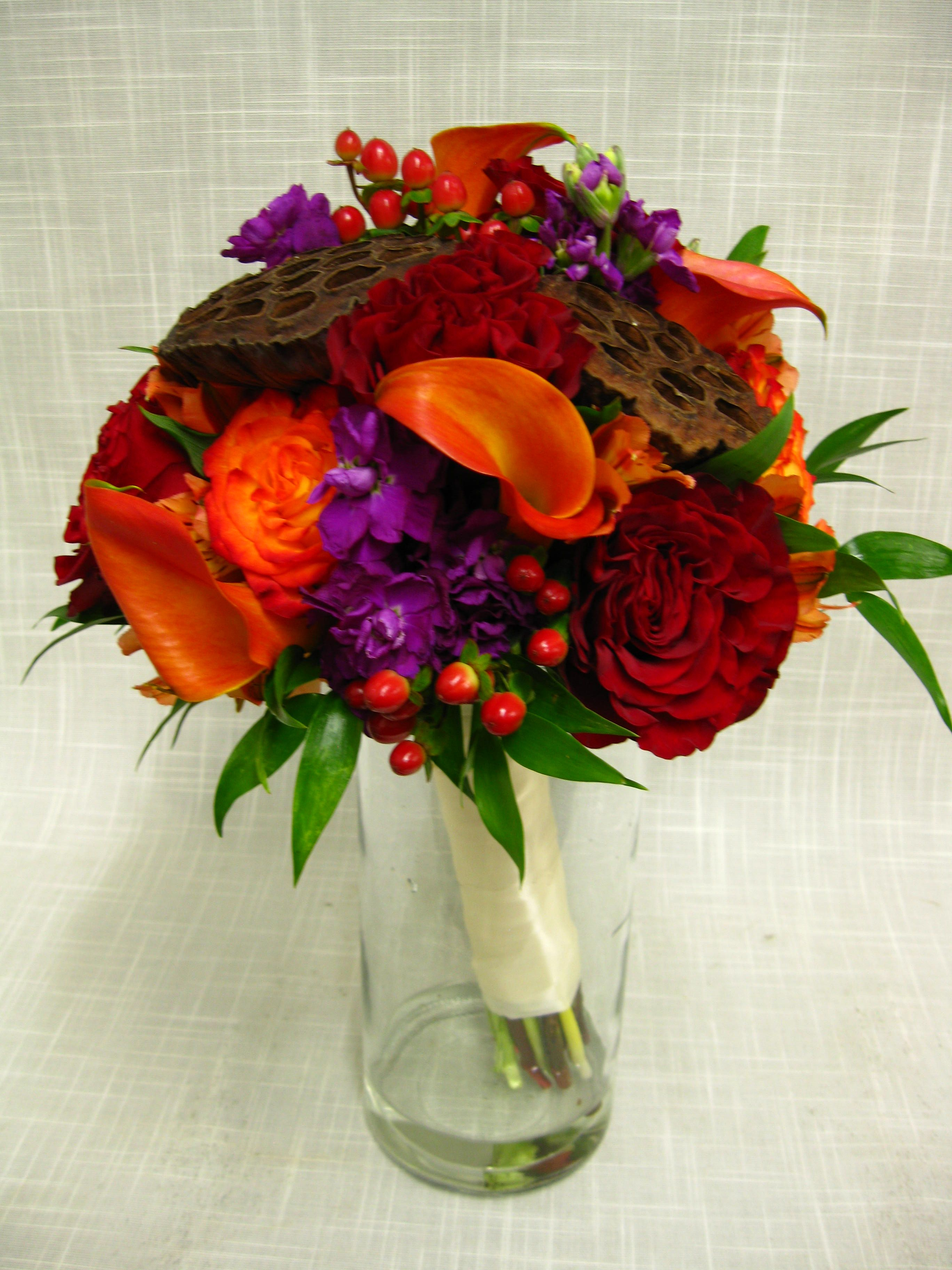 Deep rich fall toned bridal bouquet of hearts circus roses find this pin and more on shawn an tiffany wedding flowers dhlflorist Images