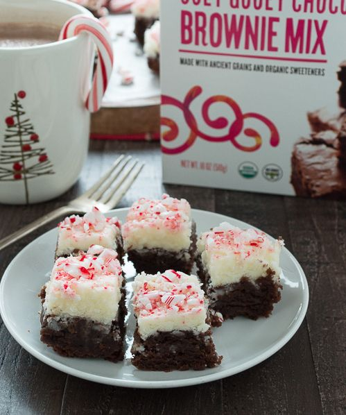 Ooey Gooey Chocolate Brownies topped with a creamy frosting and crushed peppermint!