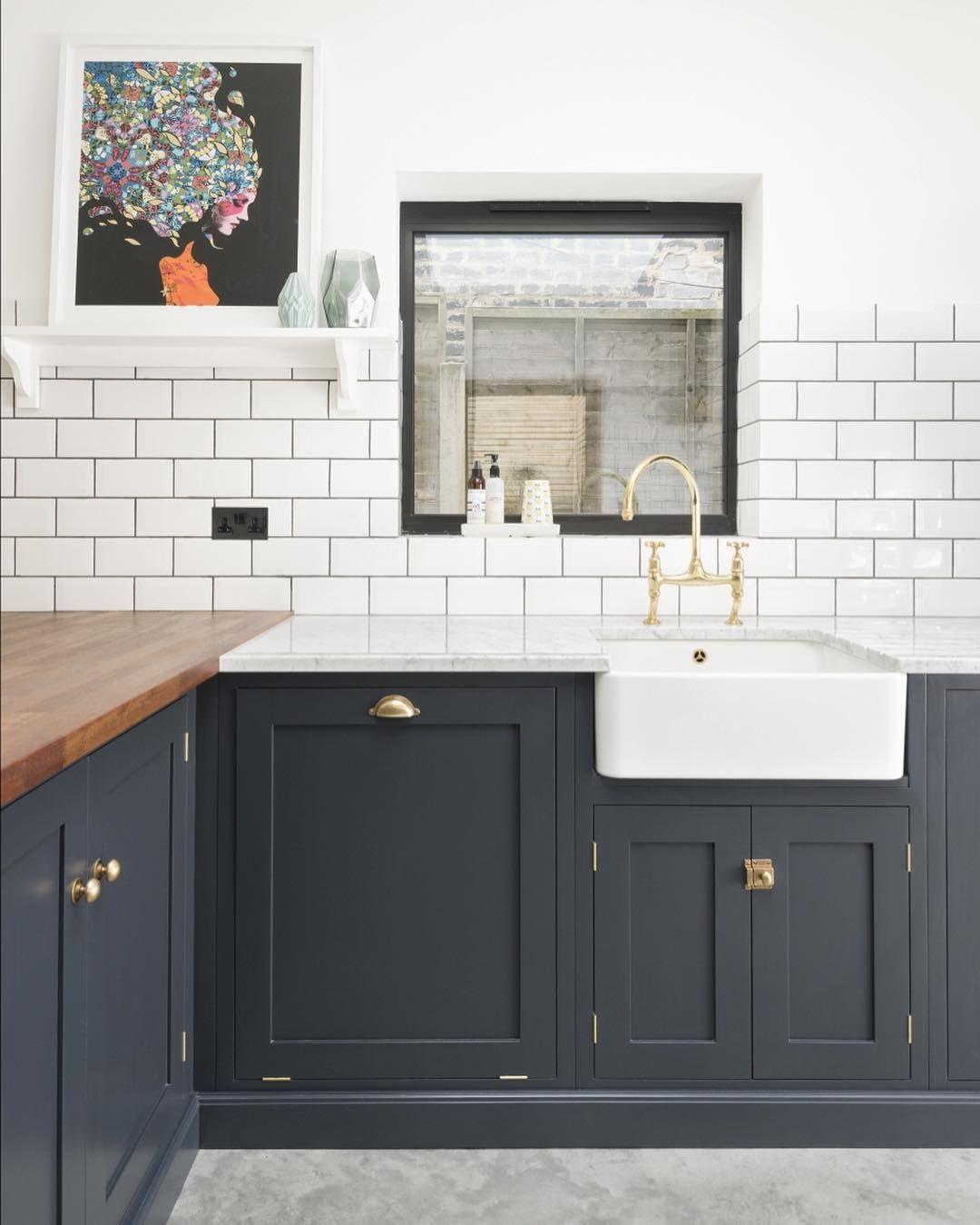 Polished concrete floors, Iroko and Carrara marble worktops, clean ...
