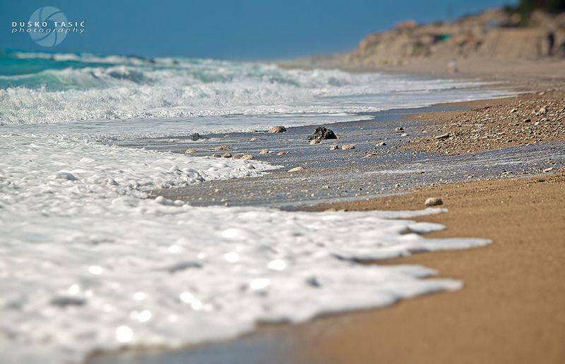 ….Sea waves on the beautiful Gialos beach, in Lefkada island, Greece