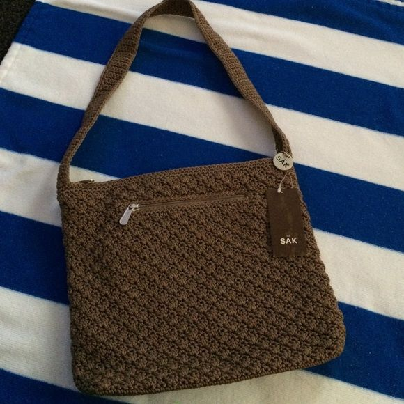 The SAK purse just reduced ♡ Nice brown SAK purse,new,,12in wide,10in long The Sak Bags