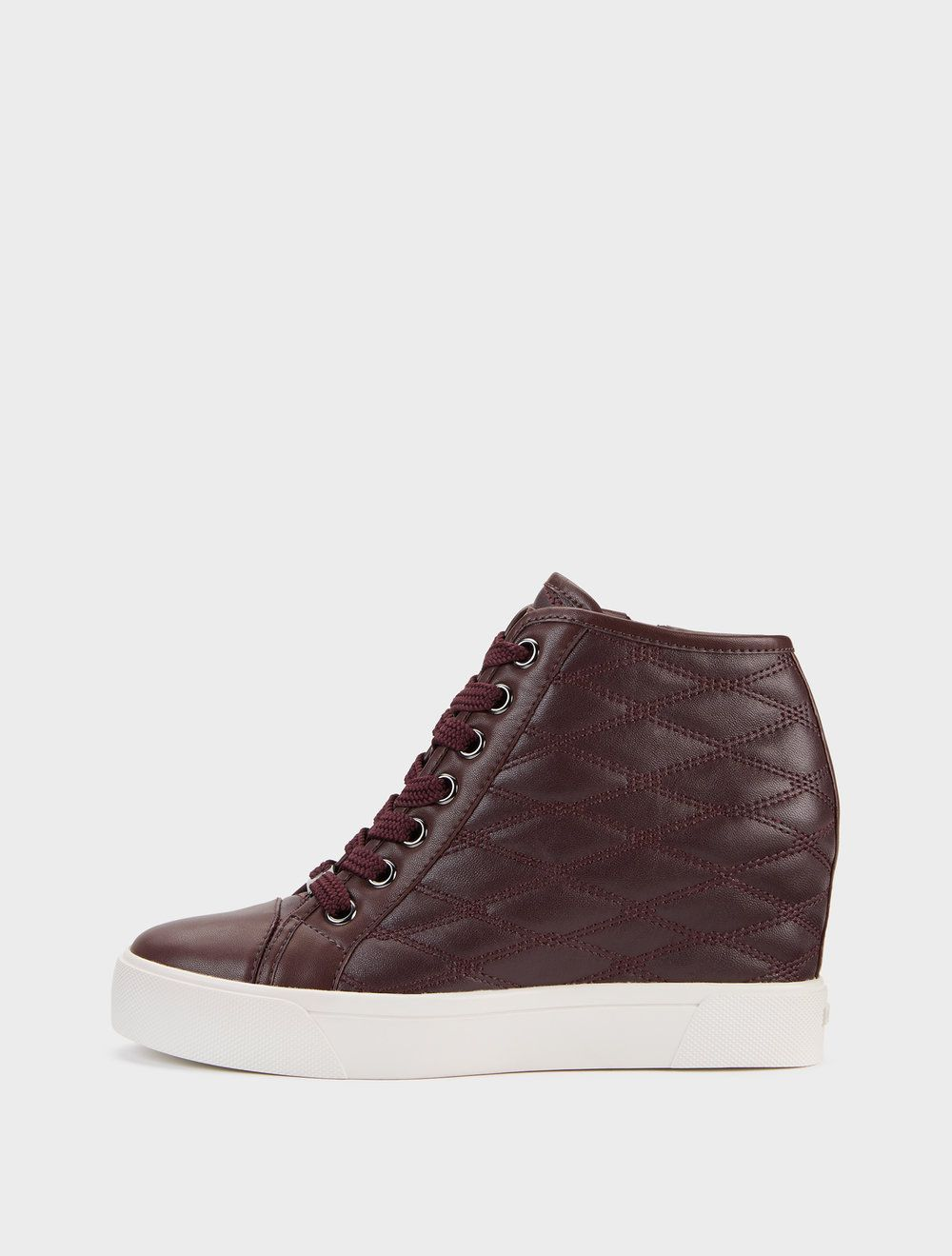 344ae19ba77 Burgundy leather Cindy Quilted Nappa Wedge Sneaker from DKNY ...