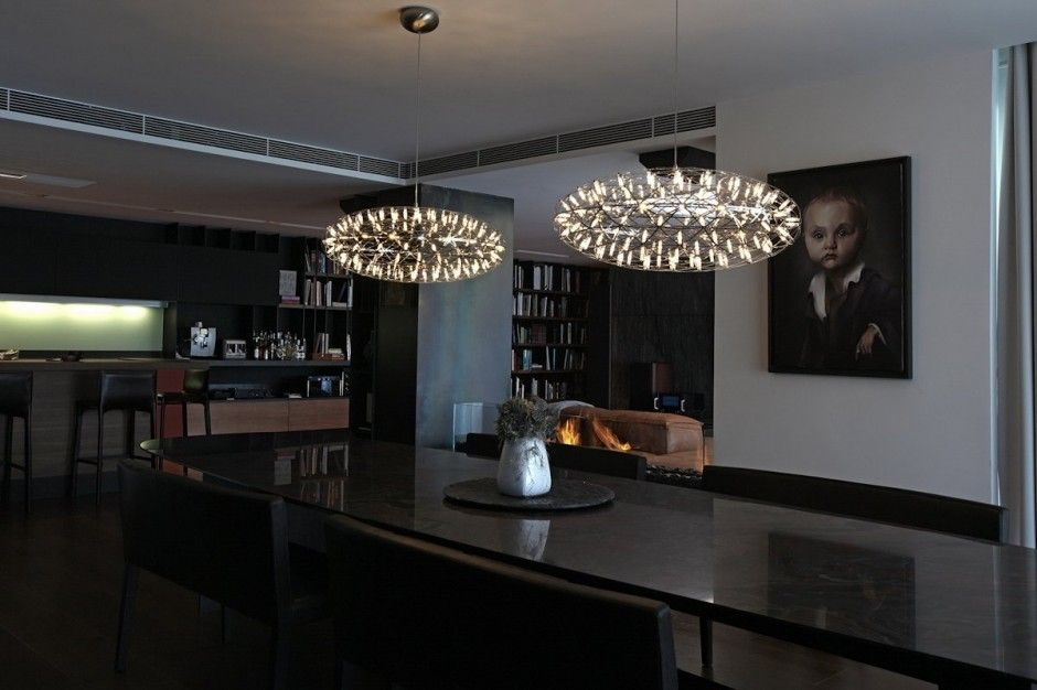http://sandavy.com/charming-stylish-dark-toned-interior-in-istanbul-designed-by-tanju-ozelgin/cute-baby-face-wallpapers-fireplace-black-marmer-large-dining-table-modern-lamps-kitchen-bar-white-wall-long-desk-chairs-mixer-library-books-wooden-cabinet-cupboards-dark-elegance-house-in-istanbul/