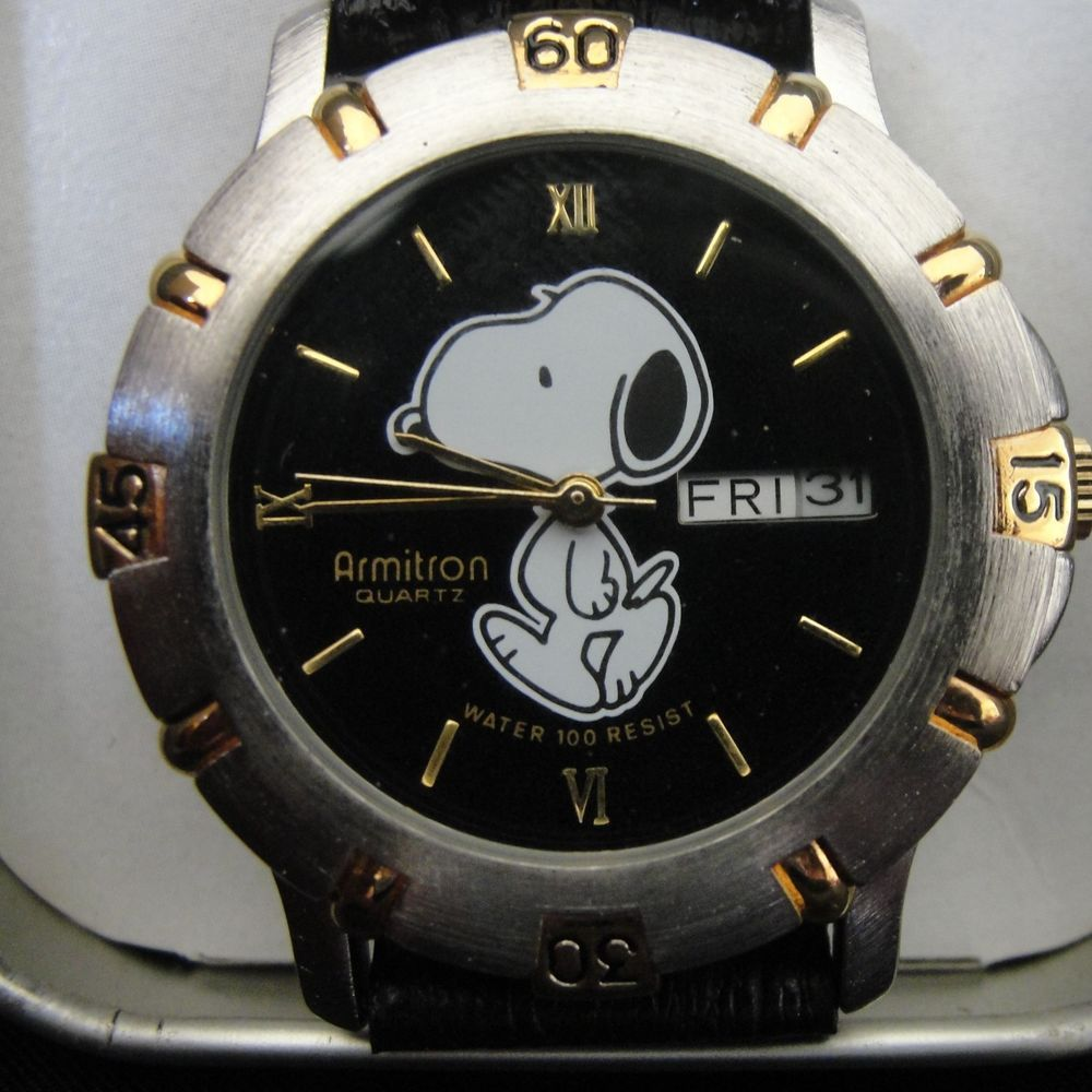 Armitron collectibles snoopy watch black leather band day date water 100 restist armitron for Snoopy watches