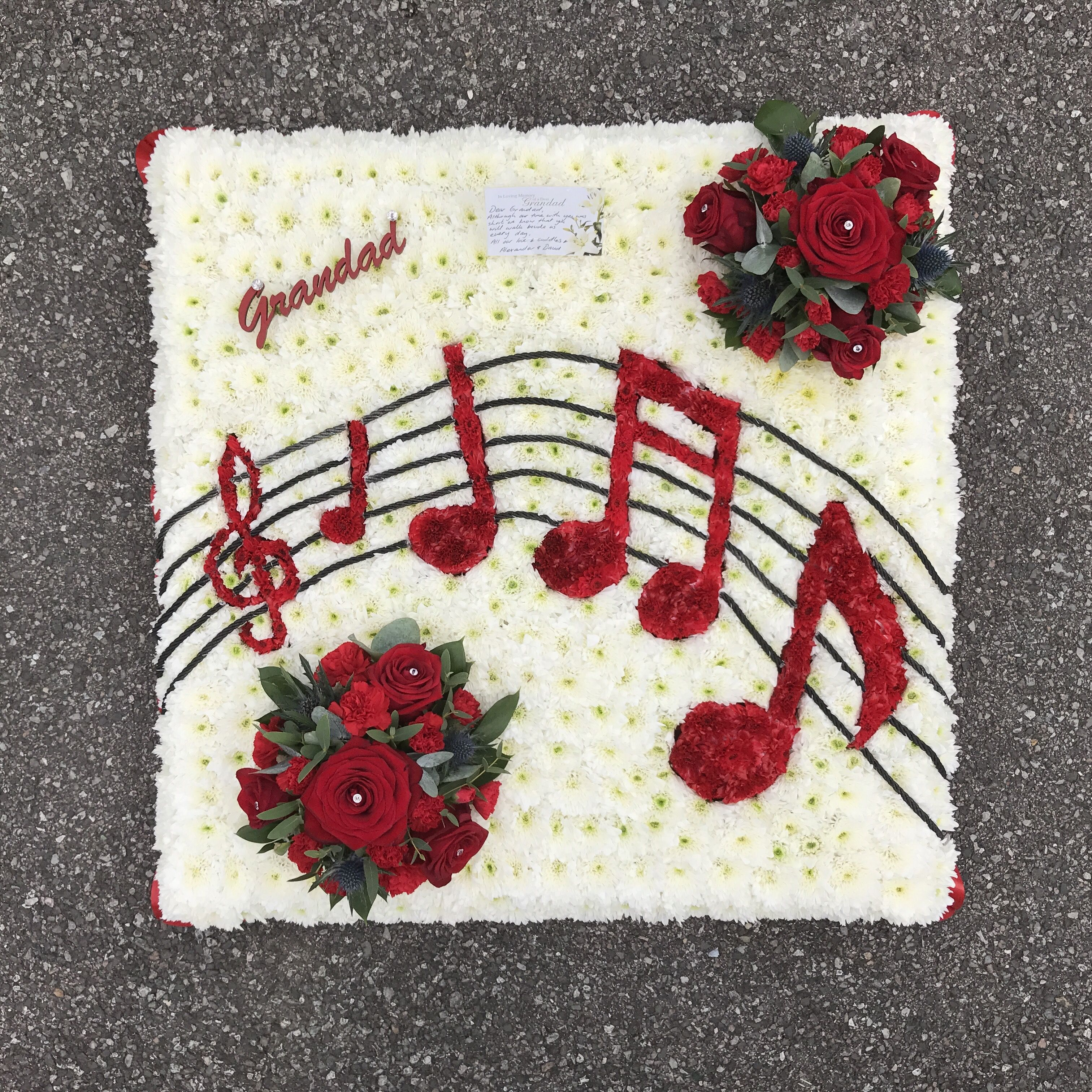 White based musical note funeral tribute with red and black white based musical note funeral tribute with red and black detailing and red rose focal flower izmirmasajfo Gallery