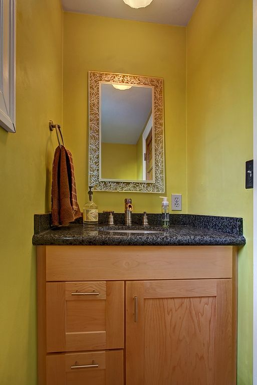 Small yellow bathroom--perfect color to brighten it up ...