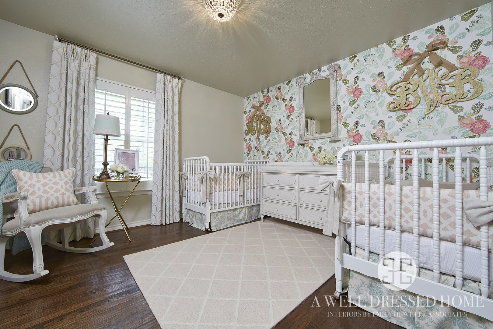 twin girls nursery by a well dressed home llc to read more about