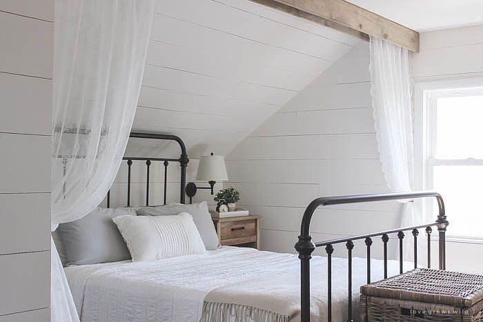 It Doesn T Get Much Cozier Than This Bedroom With Simple White Bedding A Black Wrought Iron Bed And Organic Modern Nightstands