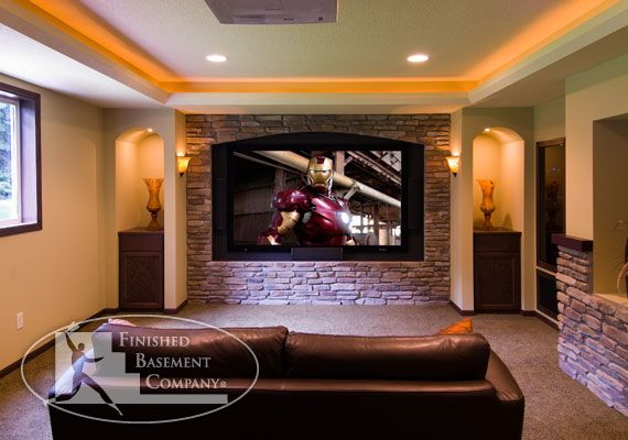 The Basement Media Room Features A Tray Lit Ceiling With Rope