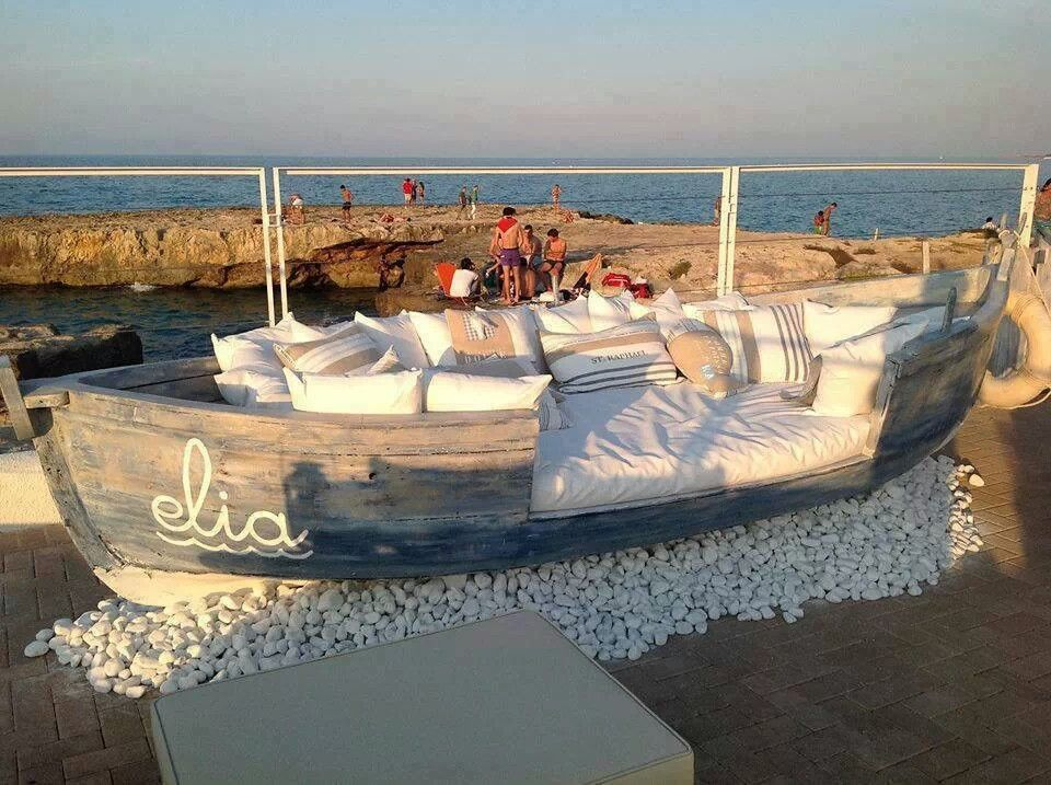 Old boat transformed into patio seating Via DIY Home Decorating