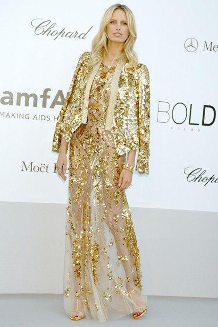 Karolina Kurkova in a Roberto Cavalli spring/summer 2012 gold sequin-embellished gown.
