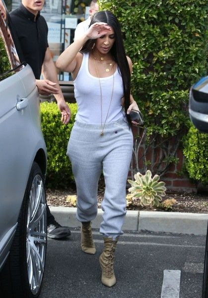 1d2af632d18dc Kim Kardashian Lace Up Boots - Kim Kardashian sealed off her street-chic  look with nude lace-up boots by Yeezy.